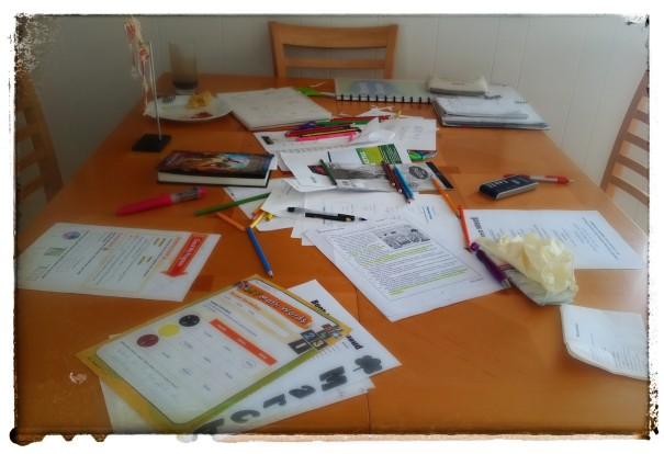 My table is there somewhere under the homework, drawings, calendars, school papers, breakfast dishes and human body skeleton. Worst part? The table has looked much, much worse...